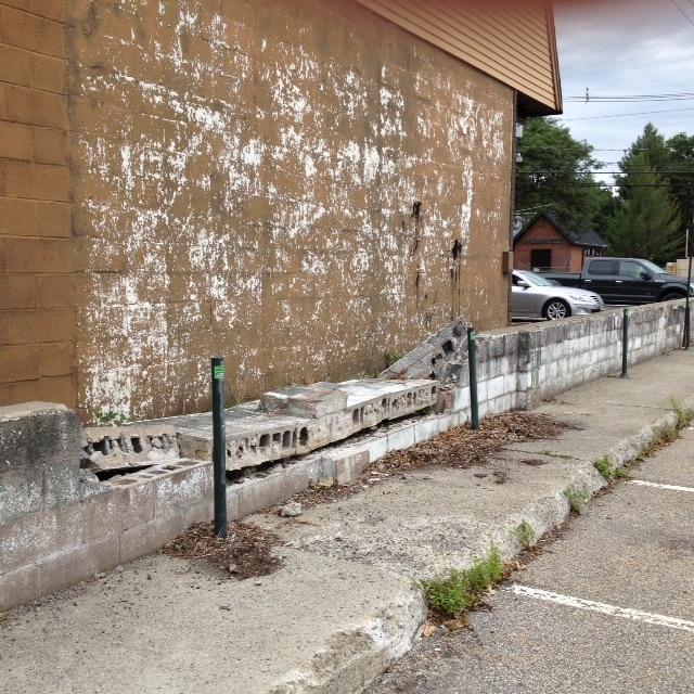 Ridgewood Town Garage employee parking retaining wall hazard